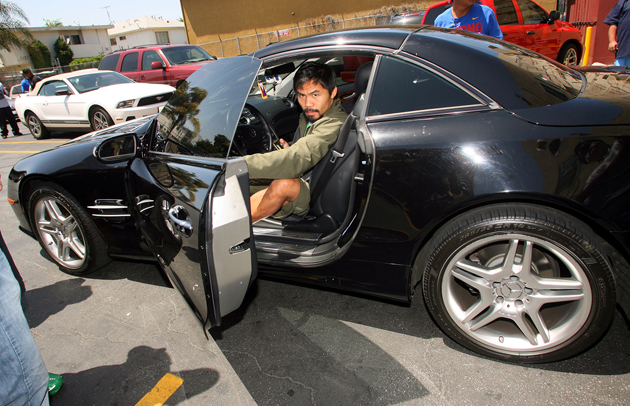 Manny Pacquiao arrives at the Wild Card Gym Wednesday for media day. (Chris Farina/Top Rank)
