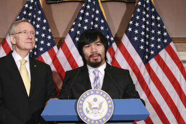 Sen. Harry Reid (D-Nev.) and boxer Manny Pacquiao (AP)