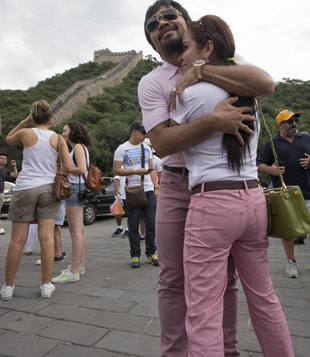 Manny Pacquiao hugs his wife, Jinkee, on the Great Wall of China (AP)