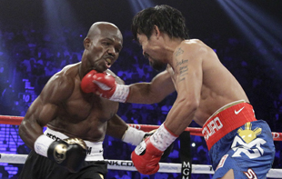 Timothy Bradley (L) takes a right on the chin from Manny Pacquiao (AP)
