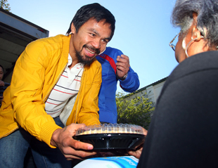 Manny Pacquiao will make about $25 million for fighting Juan Manuel Marquez (Chris Farina/Top Rank)