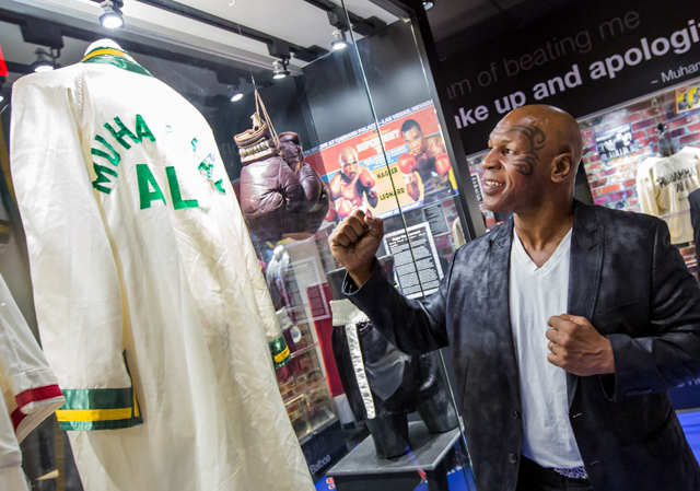 Ex-heavyweight champion Mike Tyson views the Ali Exhibit at the Boxing Hall of Fame Las Vegas (Courtesy photo)