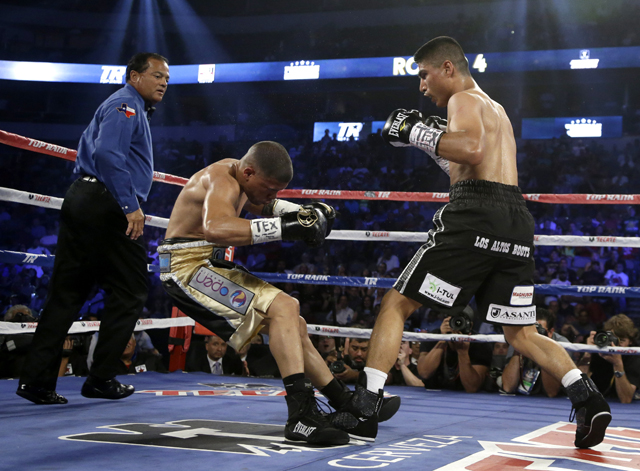 Mikey Garcia (R) scored a TKO of Juan Manuel Lopez and a ratings win for HBO (AP)