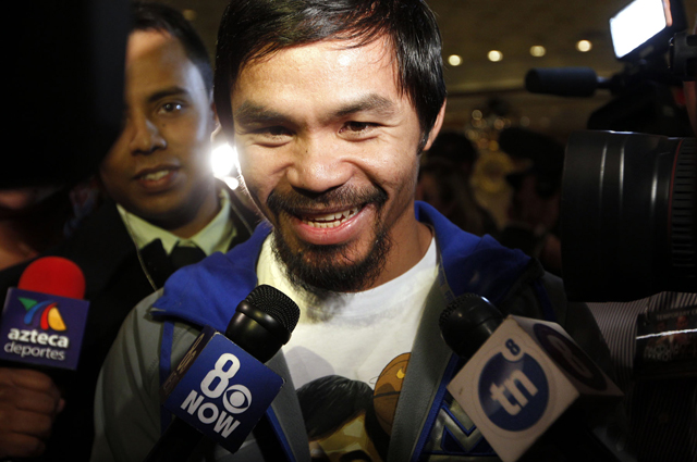 Manny Pacquiao address reporters Tuesday (Chris Farina/Top Rank)
