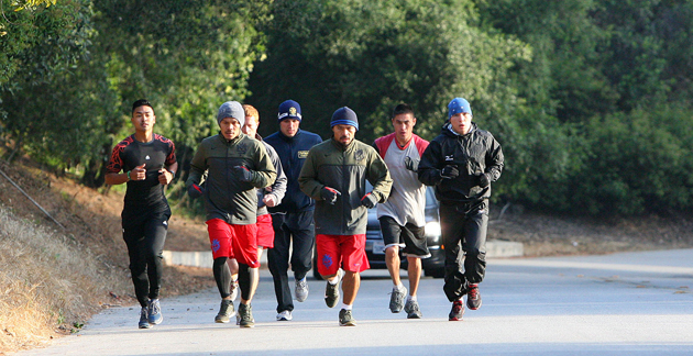 Manny Pacquiao (center) runs in Griffith Park in Los Angeles to prepare for his June 9 bout (Chris Farina/Top Rank)