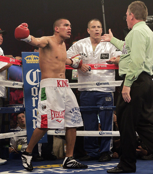 Carlos Molina argues with referee Jon Schorle after being disqualified (Bob Levey/Getty Images)