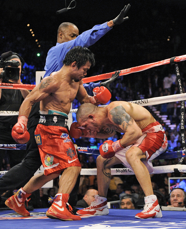 A rematch with Miguel Cotto (R) is one possibility for Manny Pacquiao on Nov. 10 (AP)