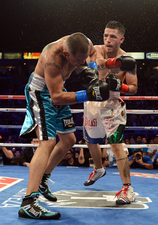 Brandon Rios (R) cracks Mike Alvarado on Oct. 13 (Getty Images)