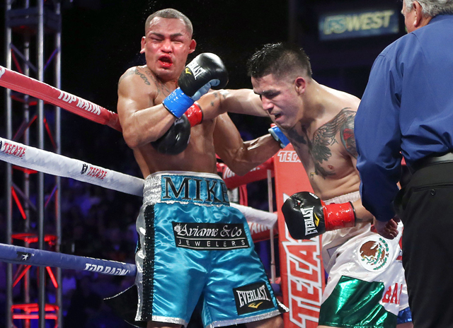 Brandon Rios (R) lands a right on Mike Alvarado in the seventh round on Saturday. (Chris Farina/Top Rank)