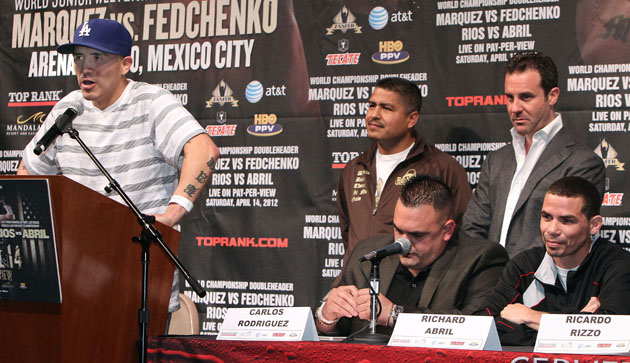 The winner of the Brandon Rios (at podium) and Richard Abril (R) fight will win a $50,000 bonus (Chris Farina/Top Rank)