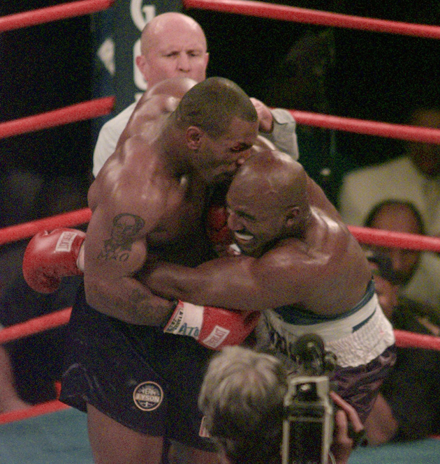 Mike Tyson bites Evander Holyfield's ear on June 28, 1997 (AP)