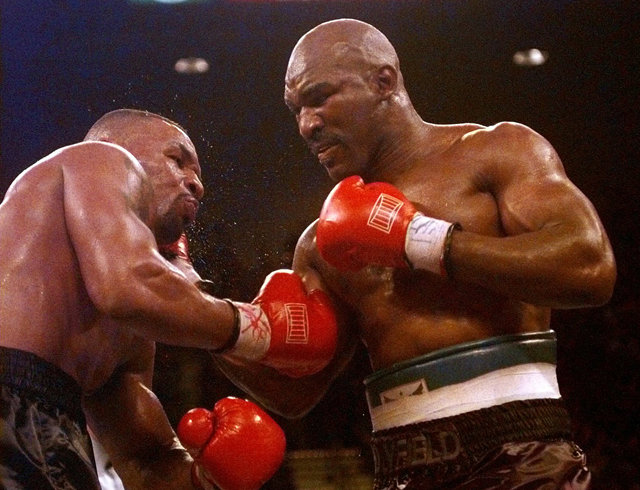 Evander Holyfield (R) on his way to stopping Mike Tyson in 1996 (AP)