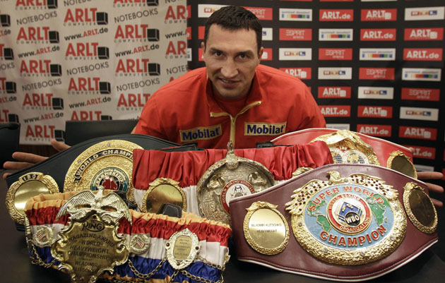 Wladimir Klitschko poses with his heavyweight title belts (AP)
