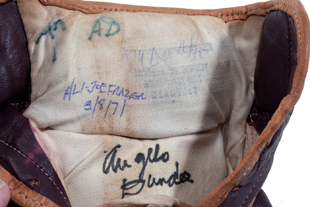 Angelo Dundee's notations in Ali's glove (SCP Auctions)