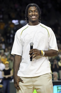 The draft has yet to happen and already RGIII is smiling. (US Presswire)