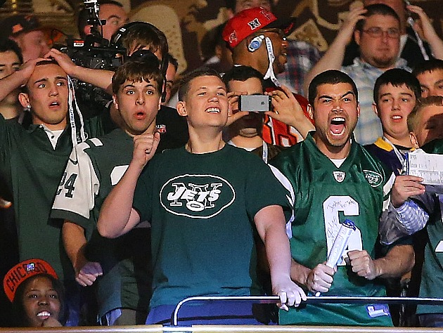 Whatever else you think of 'em, you have to agree Jets fans are photo-friendly (Getty Images)