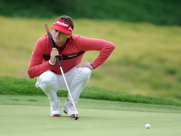 Keegan Bradley doesn't look too happy about the proximity of his recent loogie to his ball. / Getty Images