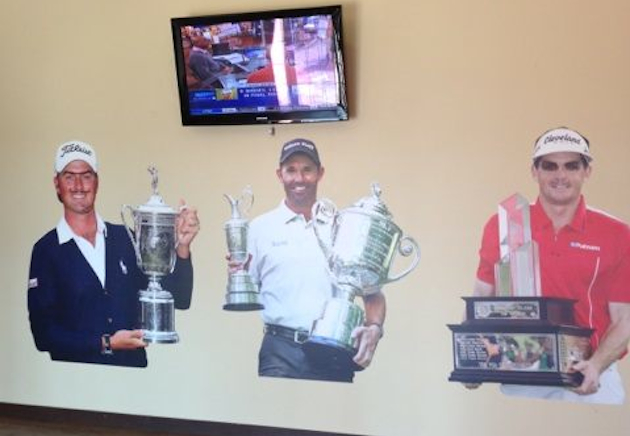 Bubba Watson has some fun with the posters on the wall. — @BubbaWatson