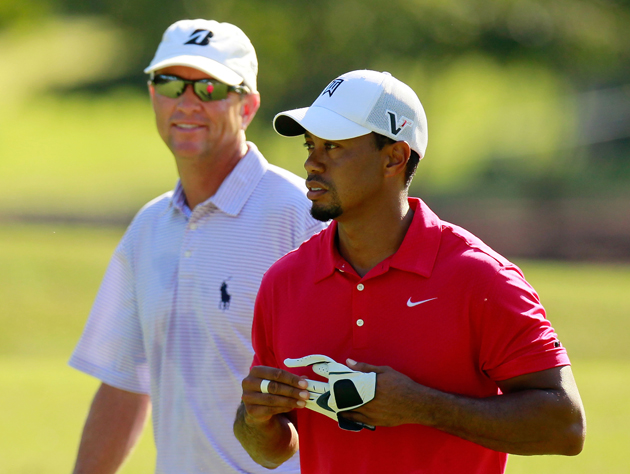 Tiger Woods and Davis Love III / Getty Images