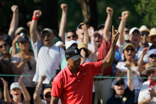 Tiger Woods on Sunday. Money. (Getty Images)