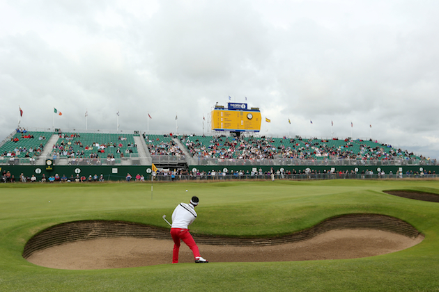 Lee Slattery of England hits a bunker shot on the 18th hole during the first round. — Getty Images
