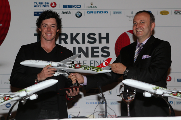 Rory McIlroy and his new model airplane. — Getty Images