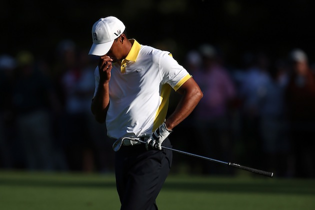 Tiger Woods reacts to his ball hitting the flagstick on No. 15 — Getty Images