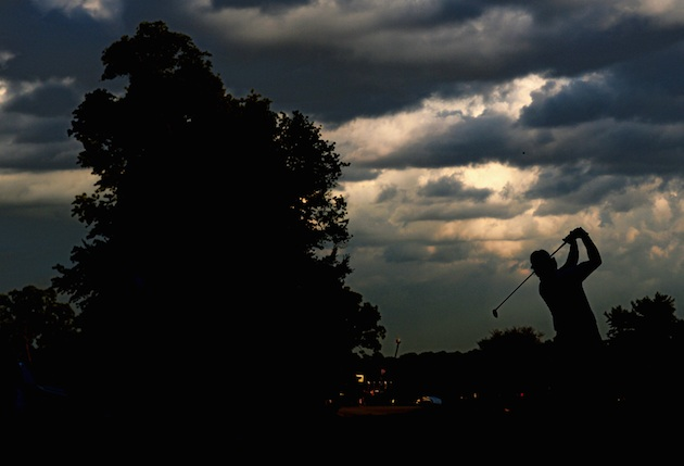 Phil Mickelson on the 16th tee Friday night. (Ross Kinnaird/Getty Images)