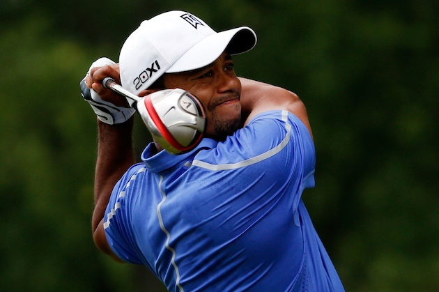 Tiger Woods tees off on the first hole on Thursday. (Getty Images)