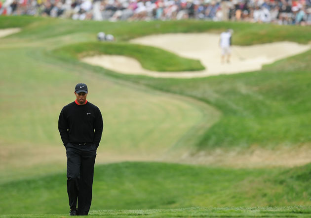 Where he walks these days, Tiger walks alone. (Getty Images)