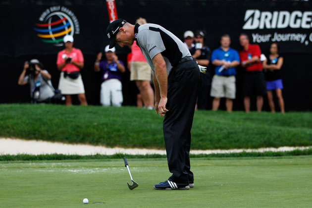 Jim Furyk sees his missed putt, and his hopes of victory, slide away. (Getty Images)