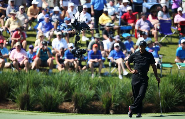 Tiger Woods cards another fine round to charge up ...