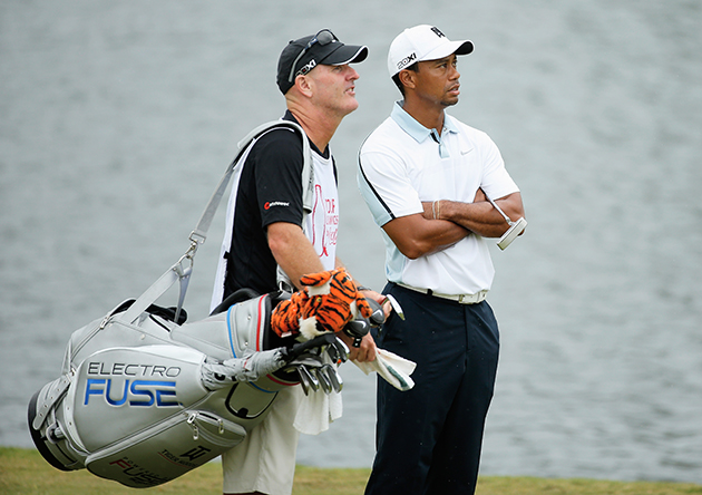Tiger Woods, Joe LaCava just want this all to be over, please. (Getty Images)