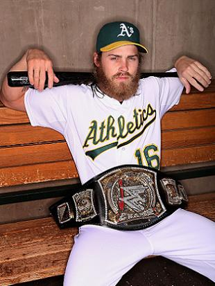 Reddick poses with a replica WWE Championship belt. (Getty)