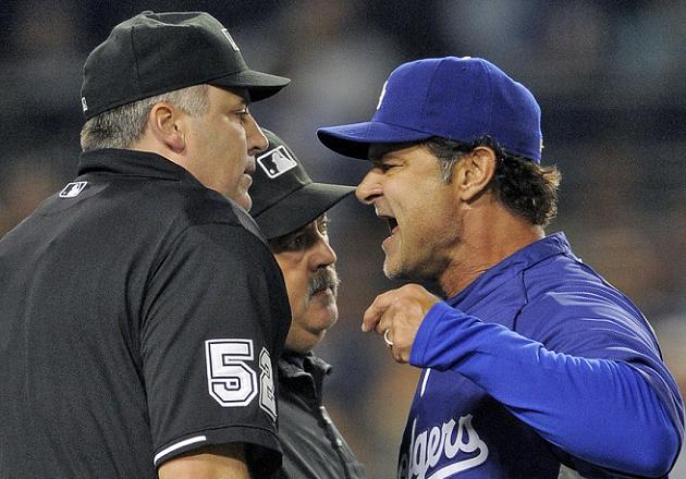 Don Mattingly gets in the face of umpire Bill Welke. (AP)