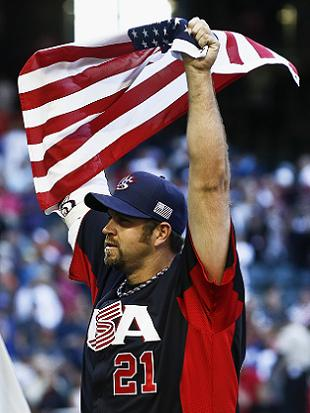 Winning pitcher Heath Bell celebrates Team USA's win. (AP)