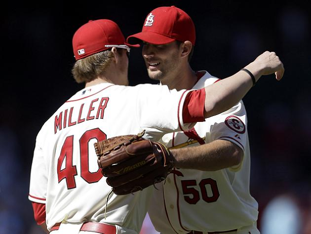 Shelby Miller embraces Adam Wainwright following Saturday's game. (AP)