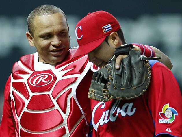 Cuba's catcher Erier Sanchez talks with winning pitcher Ismel Jimenez. (AP)