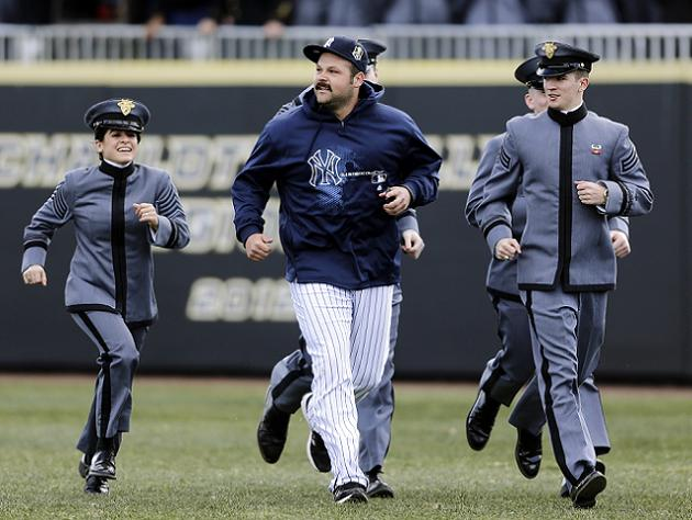 Joba Chamberlain jogs with a few cadets. (AP)