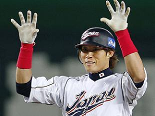 Yoshio Itoi celebrates his key hit in Japan's victory. (AP)