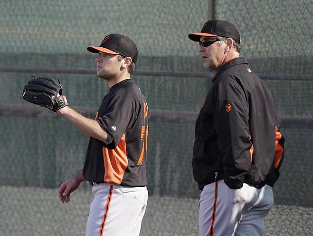 Brett and Bruce Bochy at Giants camp. (AP)