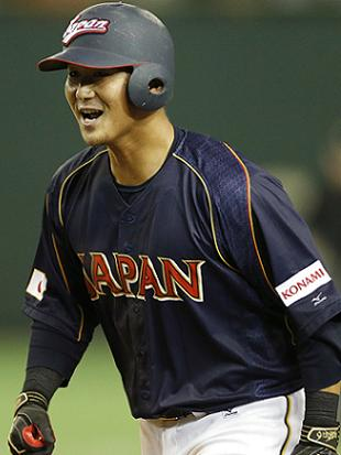 Sho Nakata celebrates his game-winning sacrifice fly. (AP)