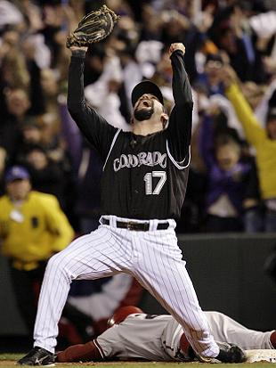 Todd Helton has played all 2,054 games of his career with the Rockies. (AP)