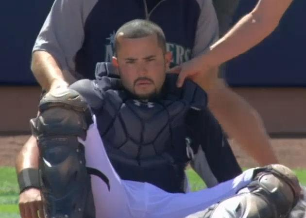A groggy Jesus Montero is helped to his feet. (MLB.TV)