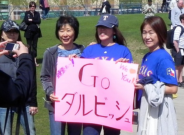 "The sign says ""Go Darvish"" and, in the upper left corner, ""Try Hard!"" (Big League Stew)"