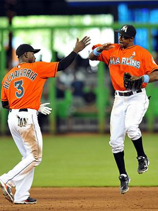 The Marlins are getting a little better at postgame high-fives. (USA Today)