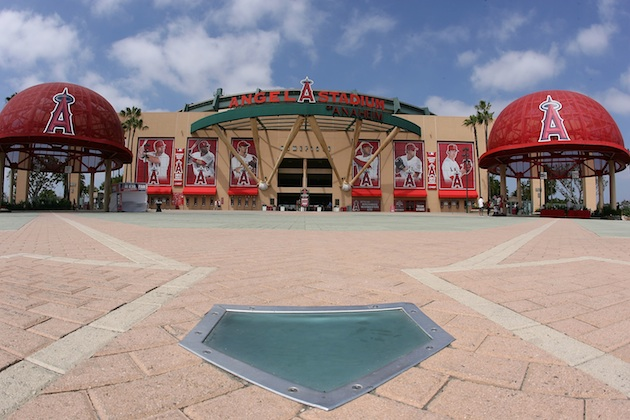 The entrance to Angel Stadium is flanked by two giant Angels caps. (Getty Images)