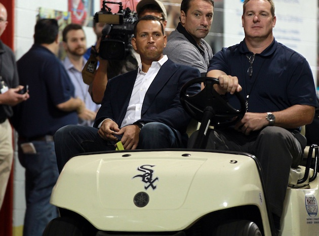 Alex Rodriguez gets a ride to the Yankees clubhouse on Monday. (Getty Images)