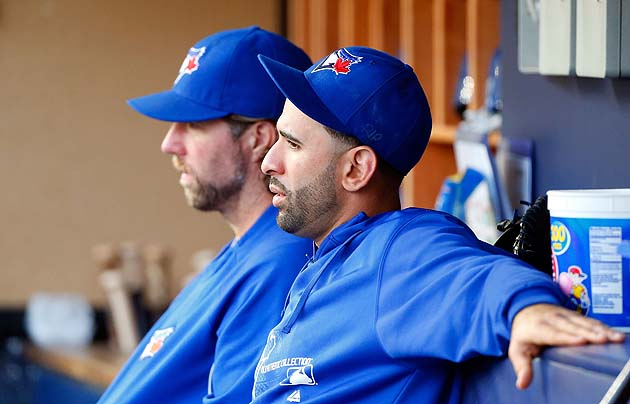 Jose Bautista and R.A. Dickey in the background show frustration in what's happening to the Toronto Blue Jays. (Getty)