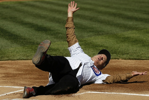 Actor Bill Murray slides into home before Thursday's Cubs game. (AP)